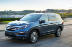 2017-Honda-Pilot-Elite-front-three-quarter-in-motion-05